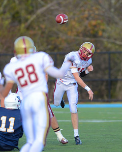 110312, Westwood, MA - Boston College High School's Dan Collins (15) fires a pass to teammate Tim Johnson (28) during Saturday's game against Xaverian Brothers. Herald photo by Ryan Hutton