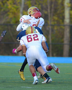 110312, Westwood, MA - Boston College High School quarterback Brendan Craven (3) is sacked by Xaverian's Ray Gobbi (64) during Saturday's game. Herald photo by Ryan Hutton