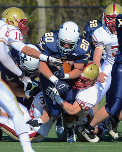 110312, Westwood, MA - Xaverian's Harry Walsh (20) is brought down by Boston College High School's Mark McGuire (88) during Saturday's game. Herald photo by Ryan Hutton
