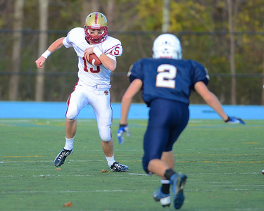 110312, Westwood, MA - Boston College High School's Dan Collins (15) rushes toward Xaverian's AJ King (2) during Saturday's game. Herald photo by Ryan Hutton