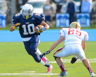 110312, Westwood, MA - Xaverian's DJ Pagliucs (10) dashes past Boston College High School's William Biggs (25) during Saturday's game. Herald photo by Ryan Hutton