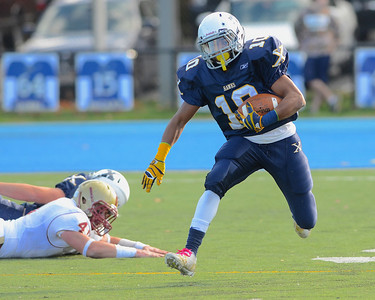 110312, Westwood, MA - Xaverian's DJ Pagliucs (10) dashes past Boston College High School's fallen Luke Catarius (41) during Saturday's game. Herald photo by Ryan Hutton