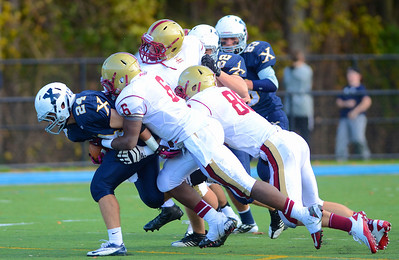 110312, Westwood, MA - Xaverian's Mike Brennan (24) is brouhght down by a flurry of Boston College High School defenders including Brandon Owens (6) and Mark McGuire (88) during Saturday's game. Herald photo by Ryan Hutton