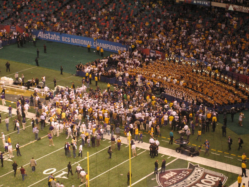 Team singing the Alma Mater with the Golden Band from Tiger Land