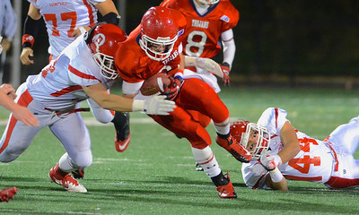 110212, Bridgewater, MA - Bridgewater-Raynham's Mike Clifford (24) is brought down by Branstable's Bryan Hardy (54) .  Herald photo by Ryan Hutton