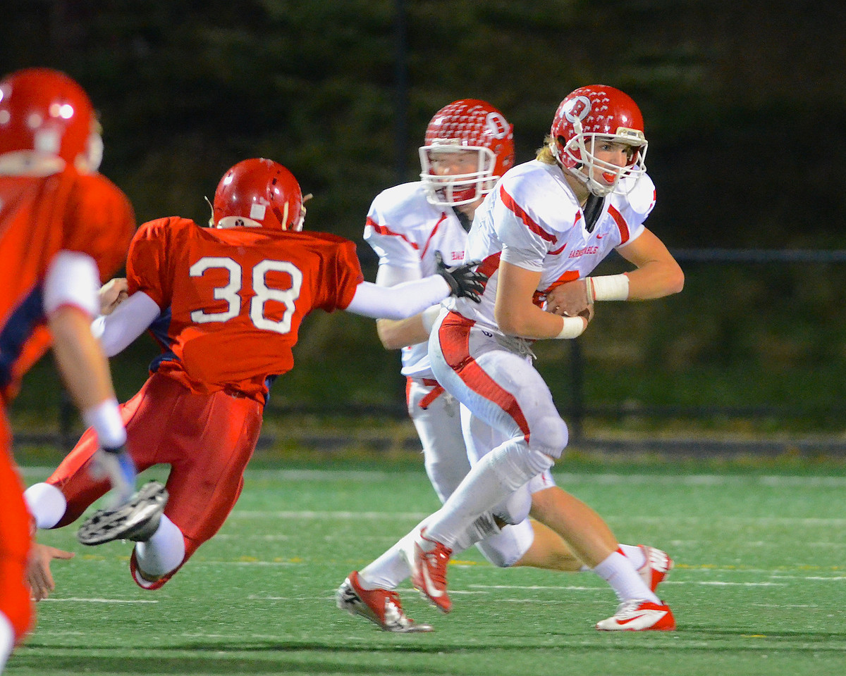110212, Bridgewater, MA - Barnstable quarterback Nick Peabody (10) fakes a hand off to teammate Hayden Murphy (8) as Bridgewater-Raynham's Kevin Newton (38) bites for it . Herald photo by Ryan Hutton