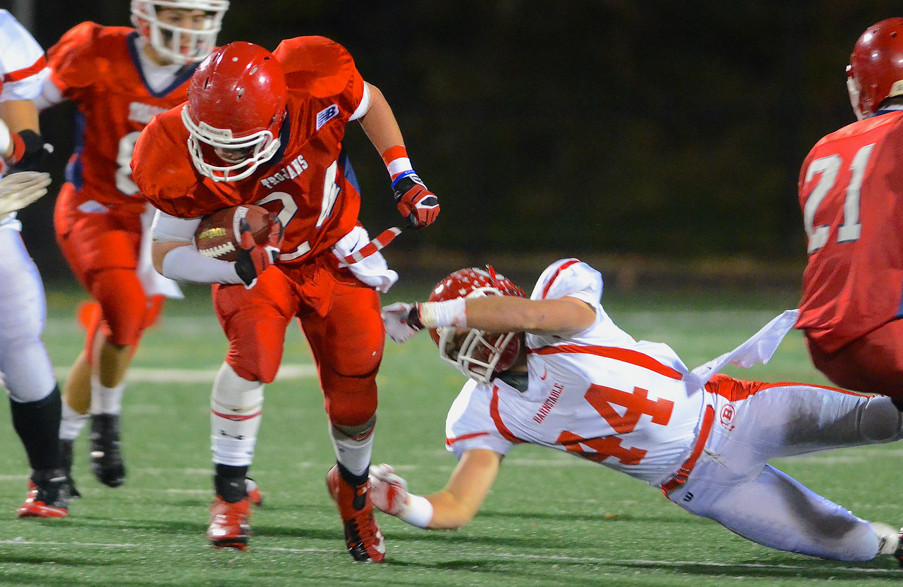 110212, Bridgewater, MA - Bridgewater-Raynham's Mike Clifford (24) charges past Branstable's Ryan Litchman (44).  Herald photo by Ryan Hutton