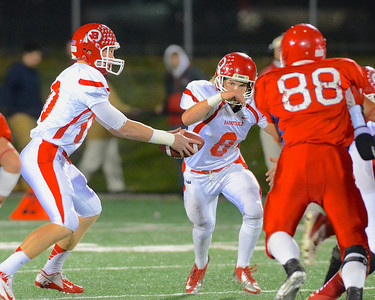 110212, Bridgewater, MA - Barnstable quarterback Nick Peabody (10) hands the ball off to teammate Hayden Murphy (8) as Bridgewater-Raynham's Kevin Johnston (88) closes in. Herald photo by Ryan Hutton