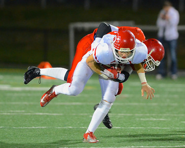 110212, Bridgewater, MA - Barnstable's Hayden Murphy (8) is taken down on a run by a Bridgewater-Raynham defender. Herald photo by Ryan Hutton
