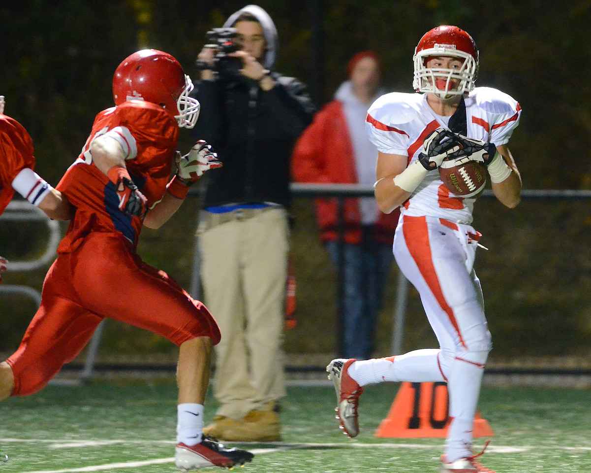 110212, Bridgewater, MA - Barnstable's Dylan Morris (2) makes a catch at the 10 yard line over the head of Bridgewater-Raynham's Kevin Wadsworth (15). Herald photo by Ryan Hutton
