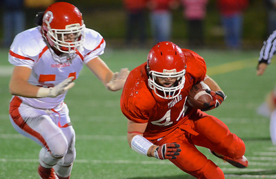 110212, Bridgewater, MA - Bridgewater-Raynham's Ryan Murphy (44) stumbles past  Branstable's Bryan Hardy (54).  Herald photo by Ryan Hutton