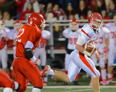110212, Bridgewater, MA - Barnstable quarterback Nick Peabody (10) makes a break for it as Bridgewater-Raynham's Aaron Conrad (12) closes in. Herald photo by Ryan Hutton