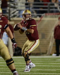 090613, Newton, MA - Boston College Quarterback Chase Rettig (11) looks for an open receiver  during Friday nights' game against Wake Forest. Herald photo by Ryan Hutton