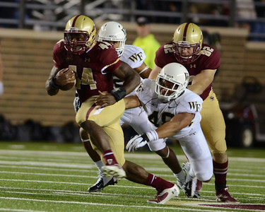 090613, Newton, MA - Boston College's Andre Williams (44) dashes past Wake Forest's Brandon Chubb (48) during the second quarter of Friday night's game. Herald photo by Ryan Hutton