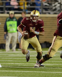 090613, Newton, MA - Boston College Quarterback Chase Rettig (11) looks for an opening after holding the ball  during the second quarter of Friday nights' game against Wake Forest. Herald photo by Ryan Hutton