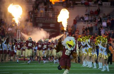 090613, Newton, MA - Lead by their mascot Baldwin, the Boston College Eagles take the field at the start of their game against Wake Forest on Friday night. Herald photo by Ryan Hutton