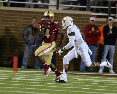 090613, Newton, MA - Boston College's Andre Williams (44) dashes past Wake Forest's Merrill Noel (7) during the second quarter of Friday night's game. Herald photo by Ryan Hutton