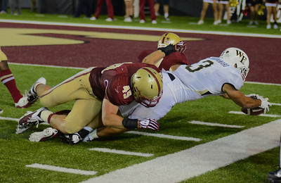 090613, Newton, MA - Wake Forest's Michael Companaro (3) is stopped at the 6 yard line on the third down by Boston College's Steele Divitto (49) during Friday night's game. Herald photo by Ryan Hutton