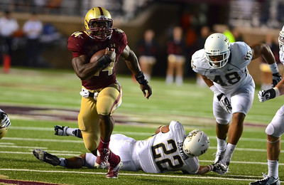 090613, Newton, MA - Boston College's Andre Williams (44) breaks a tackle by Wake Forest's Ryan Janvion (22) and Brandon Chubb (48) during the third quarter of Friday night's game. Ryan Herald photo by Ryan Hutton