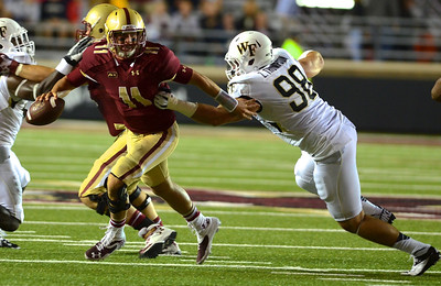 090613, Newton, MA - Boston College Quarterback Chase Rettig (11) breaks free from Wake Forest's Zach Thompson (98) during Friday nights' game. Herald photo by Ryan Hutton