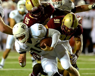 090613, Newton, MA - Wake Forest Quarterback Tanner Price (10) is sacked by Boston College's Josh Keyes (25) and Kasim Edebali (91) during the third quarter of Friday night's game. Herald photo by Ryan Hutton