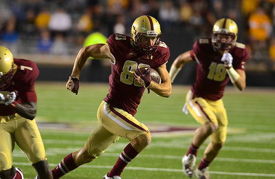 090613, Newton, MA - Boston College's Alex Amidon (83) runs in the Eagles' first touchdown minutes into Friday night's game against Wake Forest. Herald photo by Ryan Hutton