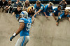 Aug 30, 2012; Detroit, MI, USA; Detroit Lions defensive tackle Ndamukong Suh (90) high fives fans while walking to the filed before the start of the preseason game against the Buffalo Bills at Ford Field. Mandatory Credit: Tim Fuller-US PRESSWIRE