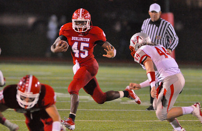 101912, Burlington, MA - Burlington's Marcus O'Diah dashes past Wakefield's Tyler MacDonald during the first quarter of Friday night's game. Herald photo by Ryan Hutton.