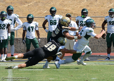 Butte College defenders Brando Phillips (88) and Tanner Cristando (96) chase down and sack quarterback Noah Suszckiewicz (5) as Butte plays its home opener Saturday, Sept. 10, 2016, against Laney College at Cowan Stadium in Butte Valley, California. (Dan Reidel -- Enterprise-Record)