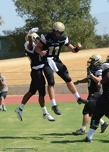 Clayotn Welch and Alex Laurel celebrate a touchdown as Butte College plays its home opener Saturday, Sept. 10, 2016, against Laney College at Cowan Stadium in Butte Valley, California. (Dan Reidel -- Enterprise-Record)