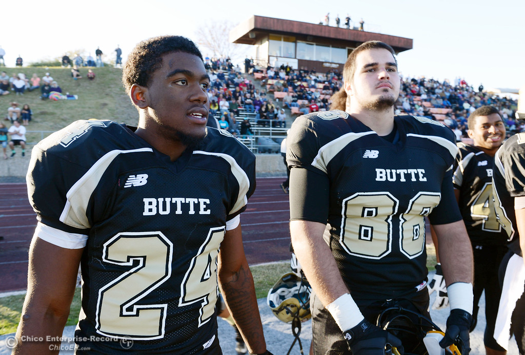 . Butte College\'s #24 Kendall Williams (left) and #88 Ralph Raetz (right) look on against City College of San Francisco in the fourth quarter of their football game at Butte\'s Cowan Stadium Saturday, November 16, 2013 in Butte Valley, Calif.  (Jason Halley/Chico Enterprise-Record)