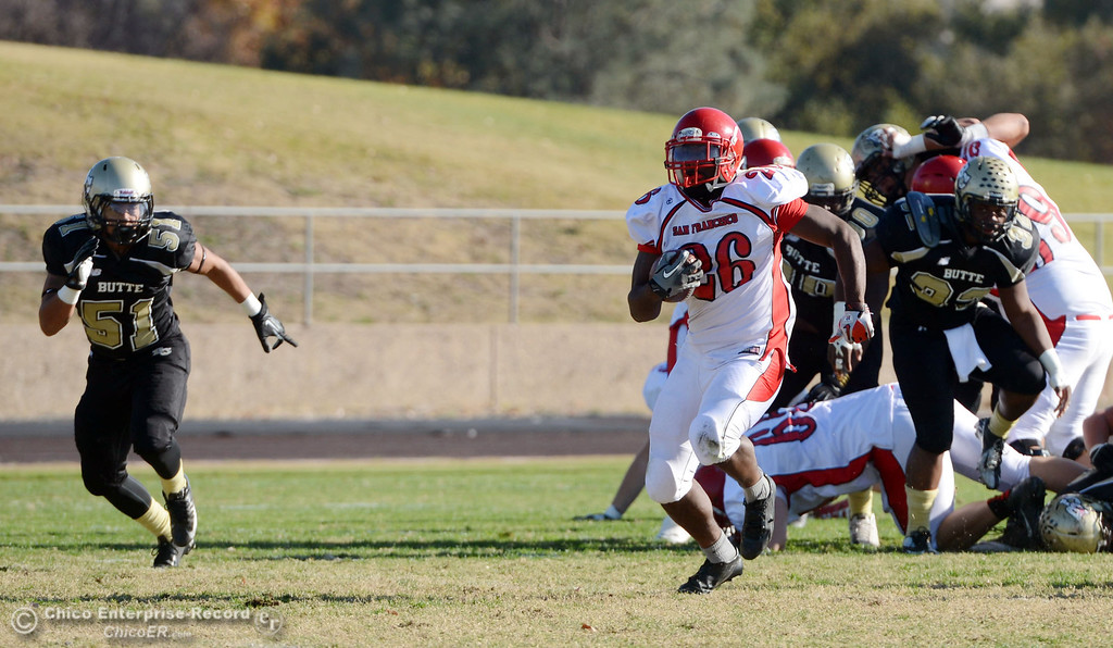 . City College of San Francisco\'s #26 Jahray Hayes rushes against Butte College\'s #51 Izaya Johnson (left) in the second quarter of their football game at Butte\'s Cowan Stadium Saturday, November 16, 2013 in Butte Valley, Calif.  (Jason Halley/Chico Enterprise-Record)