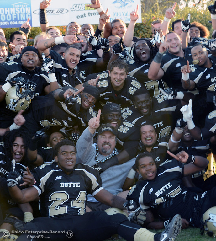 . Butte College coach Jeff Jordan celebrates with the team on their win against City College of San Francisco at the end of their football game at Butte\'s Cowan Stadium Saturday, November 16, 2013 in Butte Valley, Calif. 
