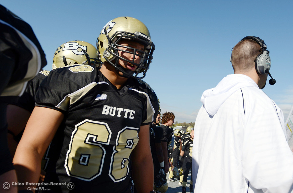 . Butte College\'s #68 Eli Thom on the sidelines against City College of San Francisco in the first quarter of their football game at Butte\'s Cowan Stadium Saturday, November 16, 2013 in Butte Valley, Calif.  (Jason Halley/Chico Enterprise-Record)