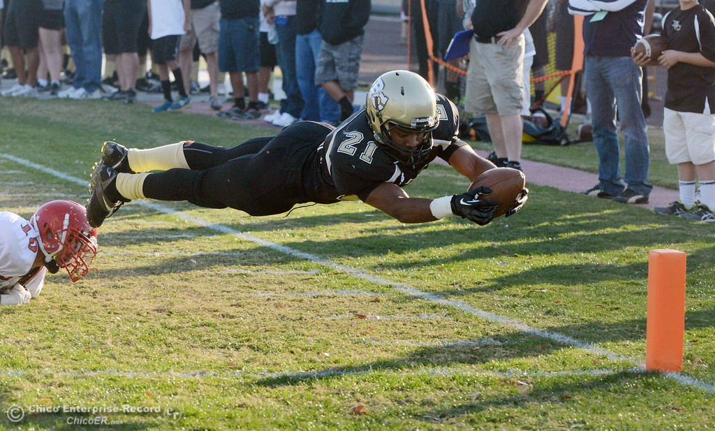 . Butte College\'s #21 Marvel Harris leaps for the end zone to score a touchdown against City College of San Francisco in the fourth quarter of their football game at Butte\'s Cowan Stadium Saturday, November 16, 2013 in Butte Valley, Calif.  (Jason Halley/Chico Enterprise-Record)