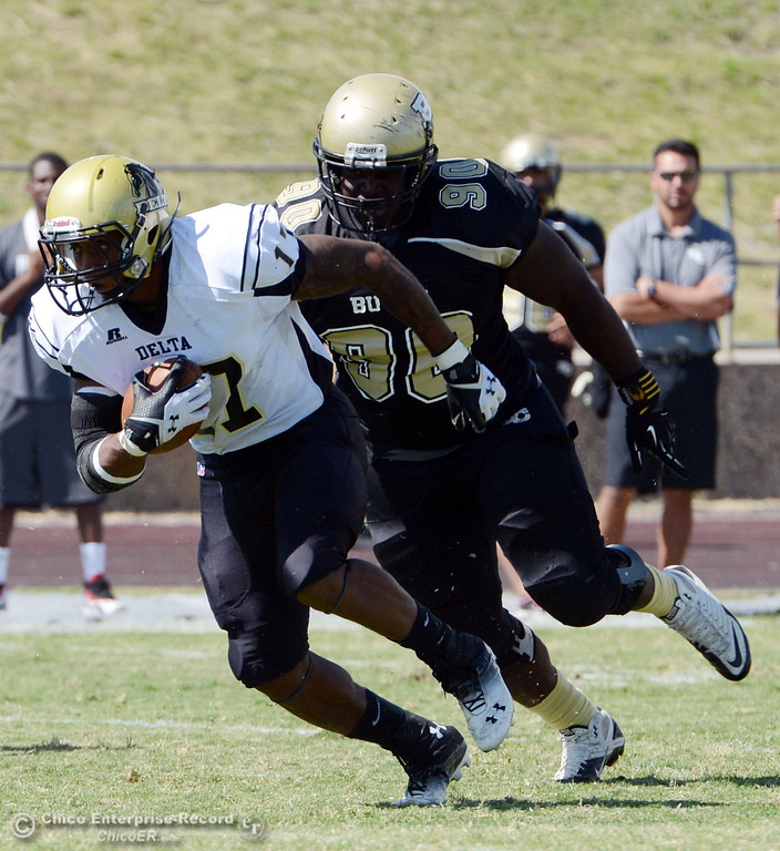 . Delta College\' s#17 Theo Wofford (left) rushes against Butte College\'s #90 Stephen Francios (right) in the first quarter of their football game at Butte\'s Cowan Stadium Saturday, September 28, 2013, in Oroville, Calif.  (Jason Halley/Chico Enterprise-Record)
