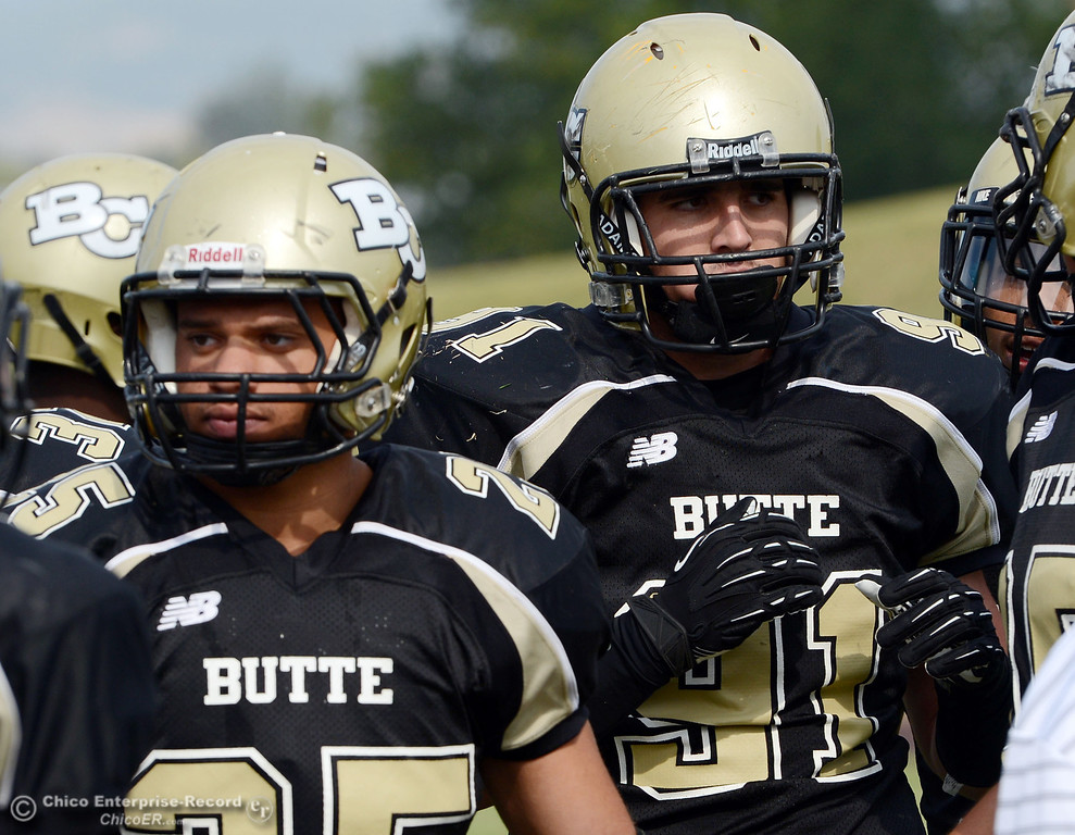 . Butte College\'s #25 De\'Aundray (left) and #91 Miek Fratianni (right) looks on against Delta College in the fourth quarter of their football game at Butte\'s Cowan Stadium Saturday, September 28, 2013, in Oroville, Calif.  (Jason Halley/Chico Enterprise-Record)