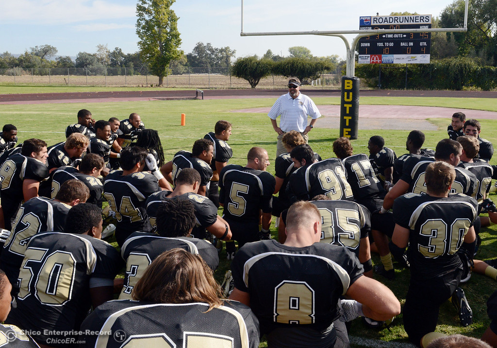 . Butte College\'s coach Jeff Jordan speaks to the team against Delta College at the end of their football game at Butte\'s Cowan Stadium Saturday, September 28, 2013, in Oroville, Calif.  (Jason Halley/Chico Enterprise-Record)