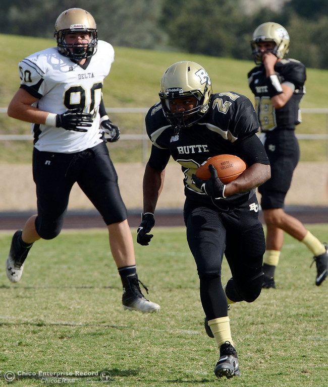 . Butte College\'s #21 Marvel Harris (right) rushes against Delta College\'s #90 Logan Finley (left) in the fourth quarter of their football game at Butte\'s Cowan Stadium Saturday, September 28, 2013, in Oroville, Calif.  (Jason Halley/Chico Enterprise-Record)