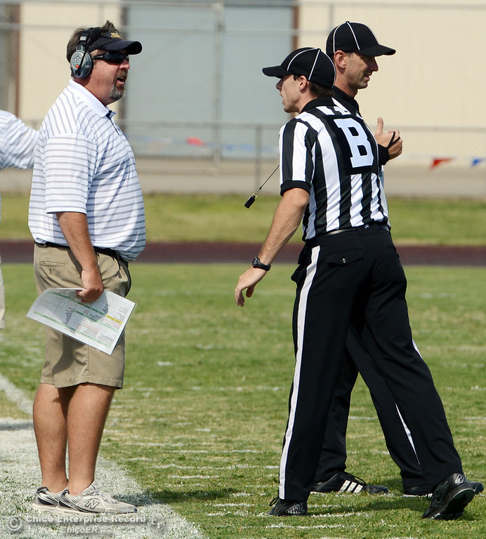 . Butte College head coach Jeff Jordan (left) argues with official Will Camy (right) against Delta College in the second quarter of their football game at Butte\'s Cowan Stadium Saturday, September 28, 2013, in Oroville, Calif.  (Jason Halley/Chico Enterprise-Record)