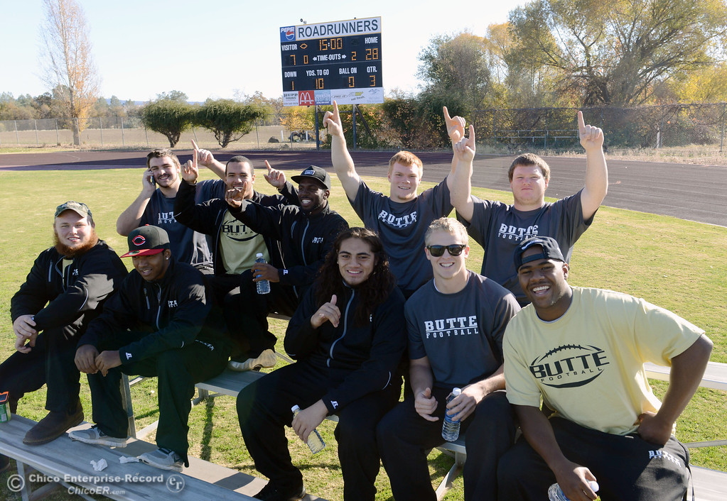 . Butte College red shirts cheer on their team against Fresno City College in the third quarter of their football game at Butte\'s Cowan Stadium Saturday, November 30, 2013 in Butte Valley, Calif.  (Jason Halley/Chico Enterprise-Record)