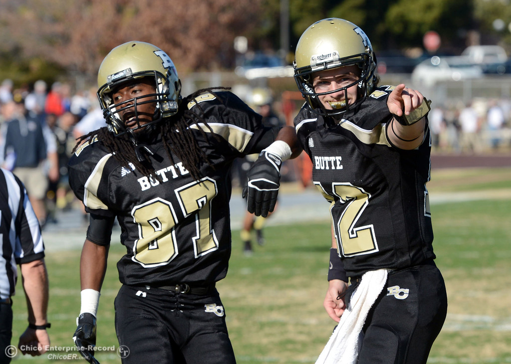 . Butte College\'s #87 Timazray Shepherd (left) scores a touchdown by a pass from #12 Thomas Stuart (right) against Fresno City College in the second quarter of their football game at Butte\'s Cowan Stadium Saturday, November 30, 2013 in Butte Valley, Calif.  (Jason Halley/Chico Enterprise-Record)