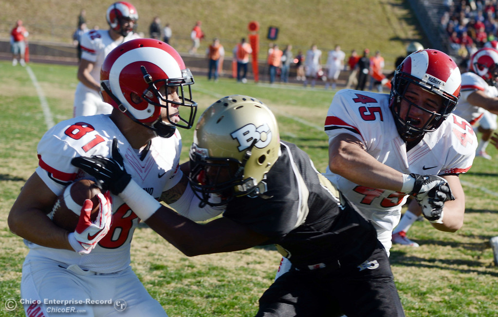 . Butte College\'s #6 Denzel Conyers (center) tackles against Fresno City College\'s #81 Justin Lea (left) as #45 Olivio Rivas (right) misses the block in the first quarter of their football game at Butte\'s Cowan Stadium Saturday, November 30, 2013 in Butte Valley, Calif.  (Jason Halley/Chico Enterprise-Record)