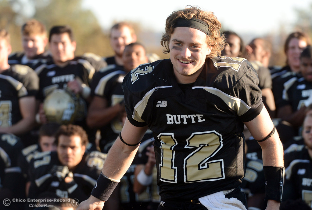 . Butte College\'s #12 Thomas Stuart accepts the Nor Cal MVP award against Fresno City College at the end of their football game at Butte\'s Cowan Stadium Saturday, November 30, 2013 in Butte Valley, Calif.  (Jason Halley/Chico Enterprise-Record)