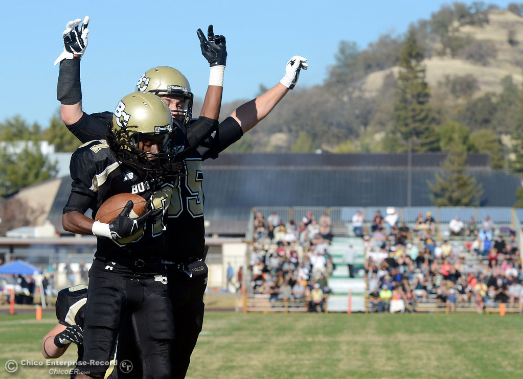 . Butte College\'s #87 Timazray Shepherd (front) and #85 Richard Murphy (back) celebrate a touchdown by Shepherd against Fresno City College in the second quarter of their football game at Butte\'s Cowan Stadium Saturday, November 30, 2013 in Butte Valley, Calif.  (Jason Halley/Chico Enterprise-Record)