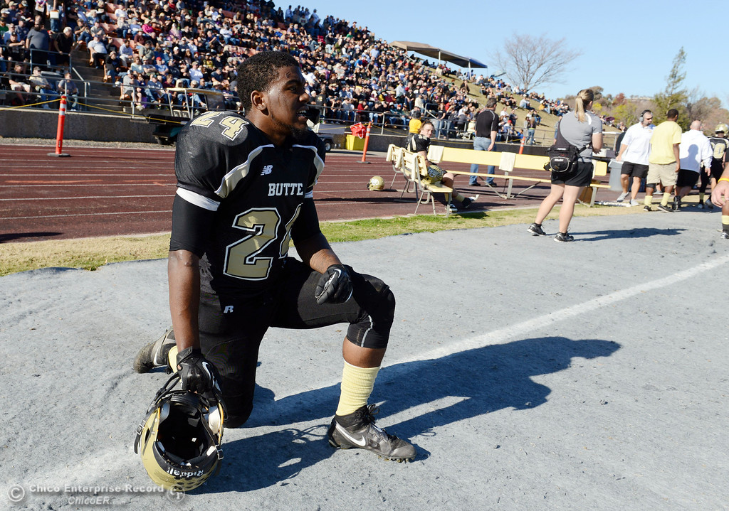 . Butte College\'s #24 Kendall Williams takes a knee of the sidelines against Fresno City College in the second quarter of their football game at Butte\'s Cowan Stadium Saturday, November 30, 2013 in Butte Valley, Calif.  (Jason Halley/Chico Enterprise-Record)