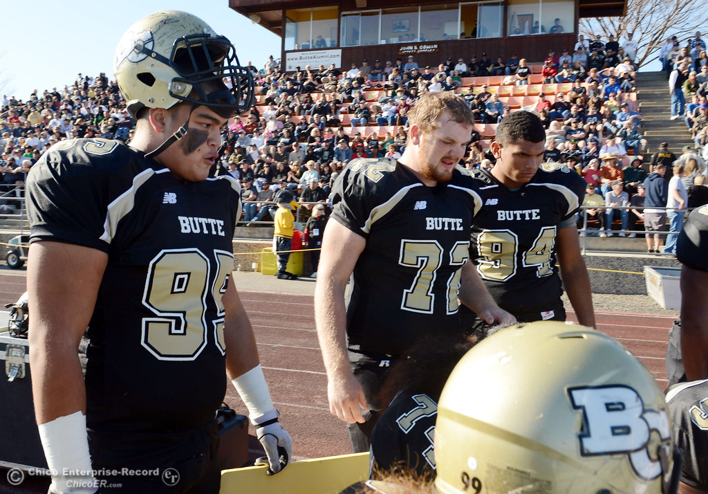 . Butte College\'s #95 Mark Rosenquist, #72 Dru Parker and #94 Shannon Dinsdale (left to right) against Fresno City College in the first quarter of their football game at Butte\'s Cowan Stadium Saturday, November 30, 2013 in Butte Valley, Calif.  (Jason Halley/Chico Enterprise-Record)