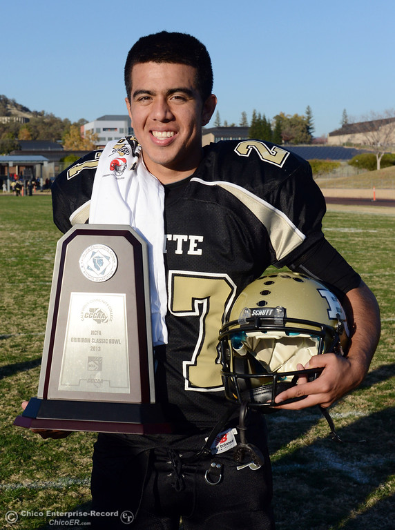 . Butte College\'s #27 Rigoberto Sanchez against Fresno City College at the end of their football game at Butte\'s Cowan Stadium Saturday, November 30, 2013 in Butte Valley, Calif.  (Jason Halley/Chico Enterprise-Record)
