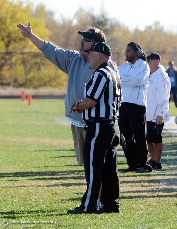 . Butte College coach Jeff Jordan talks to officials about the flags being thrown against Fresno City College in the fourth quarter of their football game at Butte\'s Cowan Stadium Saturday, November 30, 2013 in Butte Valley, Calif.  (Jason Halley/Chico Enterprise-Record)