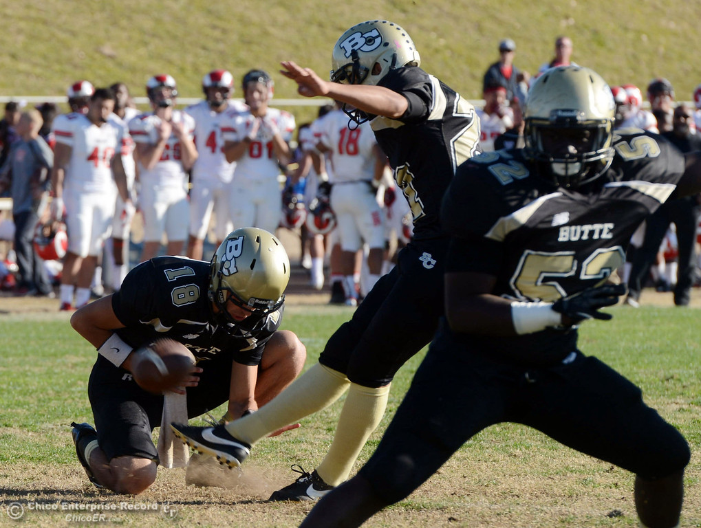 . Butte College\'s #27 Rigoberto Sanchez misses his first extra point against Fresno City College in the third quarter of their football game at Butte\'s Cowan Stadium Saturday, November 30, 2013 in Butte Valley, Calif.  (Jason Halley/Chico Enterprise-Record)